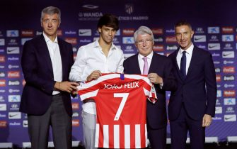 epa07703257 Portuguese player Joao Felix (2-L) poses for  photographs with (from left) Atletico Madrid's Managing Director, Miguel Angel Gil Marin; club's President, Enrique Cerezo, and team's Sport Director, Andrea Berta, during his presentation as new Atletico Madrid player at Wanda Metropolitano Stadium, in Madrid, Spain, 08 July 2019. The 19-year-old Felix came from Portuguese side SL Benfica.  EPA/Juan Carlos Hidalgo