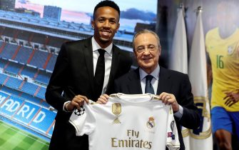 epa07707293 Real Madrid's President, Florentino Perez (R) and Brazilian defender Eder Militao pose for the photographers during the presentation of the player at Santiago Bernabeu Stadium, in Madrid, Spain, 10 July 2019.  EPA/Juanjo Guillen