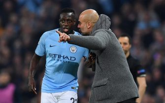 Manchester City's Spanish manager Pep Guardiola gestures to Manchester City's French defender Benjamin Mendy during the UEFA Champions League quarter final second leg football match between Manchester City and Tottenham Hotspur at the Etihad Stadium in Manchester, north west England on April 17, 2019. (Photo by Ben STANSALL / AFP)        (Photo credit should read BEN STANSALL/AFP/Getty Images)