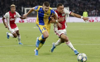 AMSTERDAM, NETHERLANDS - AUGUST 28: (L-R) Roman Bezjak of APOEL, Sergino Dest of Ajax  during the UEFA Champions League  match between Ajax v Apoel Nicosia at the Johan Cruijff Arena on August 28, 2019 in Amsterdam Netherlands (Photo by Erwin Spek/Soccrates/Getty Images)