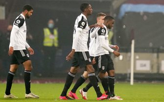 epa08806307 Ademola Lookman (R) of Fulham is consoled by teammates after the English Premier League soccer match between West Ham United and Fulham in London, Britain, 07 November 2020. Lookman failed to score with a penalty in the last minute of added time and West Ham won 1-0.  EPA/John Walton / POOL EDITORIAL USE ONLY. No use with unauthorized audio, video, data, fixture lists, club/league logos or 'live' services. Online in-match use limited to 120 images, no video emulation. No use in betting, games or single club/league/player publications.