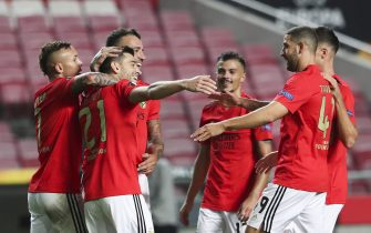 epa08784772 Benfica player Pizzi (2-L) celebrates after scoring the 3-0 goal during the UEFA Europa League group D match between Benfica and Standard Liege, at Luz Stadium in Lisbon, Portugal, 29 October 2020.  EPA/JOSE SENA GOULAO