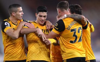 epa08773612 Raul Jimenez (C) of Wolverhampton celebrates with teammates after scoring the opening goal during the English Premier League match between Wolverhampton Wanderers and Newcastle United in Wolverhampton, Britain, 25 October 2020.  EPA/Alex Pantling / POOL EDITORIAL USE ONLY. No use with unauthorized audio, video, data, fixture lists, club/league logos or 'live' services. Online in-match use limited to 120 images, no video emulation. No use in betting, games or single club/league/player publications.
