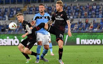 ROME, ITALY - JULY 04: Sergei Milinkovic-Savic of SS Lazio competes for the ball with Alexis Saelemaekers and Simon Kjaer of AC Milan ,during the Serie A match between SS Lazio and AC Milan at Stadio Olimpico on July 4, 2020 in Rome, Italy. (Photo by MB Media/Getty Images)