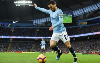 Manchester City's Spanish midfielder David Silva looks to pass the ball during the English Premier League football match between Manchester City and Arsenal at the Etihad Stadium in Manchester, north west England, on February 3, 2019. (Photo by Paul ELLIS / AFP) / RESTRICTED TO EDITORIAL USE. No use with unauthorized audio, video, data, fixture lists, club/league logos or 'live' services. Online in-match use limited to 120 images. An additional 40 images may be used in extra time. No video emulation. Social media in-match use limited to 120 images. An additional 40 images may be used in extra time. No use in betting publications, games or single club/league/player publications. /         (Photo credit should read PAUL ELLIS/AFP via Getty Images)