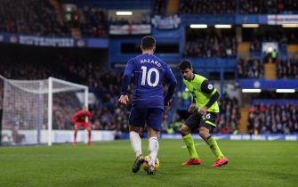 LONDON, ENGLAND - FEBRUARY 02: Eden Hazard of Chelsea takes on Christopher Schindler of Huddersfield Town during the Premier League match between Chelsea FC and Huddersfield Town at Stamford Bridge on February 02, 2019 in London, United Kingdom. (Photo by Richard Heathcote/Getty Images)