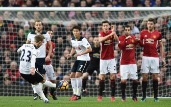 Tottenham Hotspur's Danish midfielder Christian Eriksen (L) takes a freekick during the English Premier League football match between Manchester United and Tottenham Hotspur at Old Trafford in Manchester, north west England, on December 11, 2016. / AFP / OLI SCARFF / RESTRICTED TO EDITORIAL USE. No use with unauthorized audio, video, data, fixture lists, club/league logos or 'live' services. Online in-match use limited to 75 images, no video emulation. No use in betting, games or single club/league/player publications.  /         (Photo credit should read OLI SCARFF/AFP via Getty Images)
