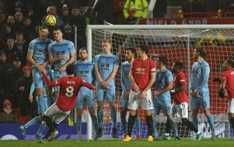Manchester United's Spanish midfielder Juan Mata (L) takes a freekick during the English Premier League football match between Manchester United and Burnley at Old Trafford in Manchester, north west England, on January 22, 2020. (Photo by Paul ELLIS / AFP) / RESTRICTED TO EDITORIAL USE. No use with unauthorized audio, video, data, fixture lists, club/league logos or 'live' services. Online in-match use limited to 120 images. An additional 40 images may be used in extra time. No video emulation. Social media in-match use limited to 120 images. An additional 40 images may be used in extra time. No use in betting publications, games or single club/league/player publications. /  (Photo by PAUL ELLIS/AFP via Getty Images)