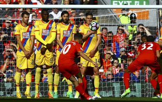 Liverpool's Brazilian midfielder Philippe Coutinho (C) scores during the English Premier League football match between Liverpool and Crystal Palace at Anfield in Liverpool, north west England on April 23, 2017. / AFP PHOTO / Geoff CADDICK / RESTRICTED TO EDITORIAL USE. No use with unauthorized audio, video, data, fixture lists, club/league logos or 'live' services. Online in-match use limited to 75 images, no video emulation. No use in betting, games or single club/league/player publications.  /         (Photo credit should read GEOFF CADDICK/AFP via Getty Images)