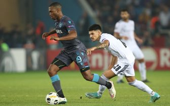 epa07893627 Basel's Raoul Petretta (R) in action against Trabzonspor's Daniel Sturridge (L) during the UEFA Euroa League group C match between Trabzonspor and Basel in Trabzon, Turkey 03 October 2019.  EPA/TOLGA BOZOGLU