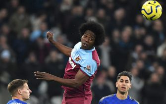 epa08093032 West Ham's Carlos Sanchez (C) heads the ball during the English Premier league soccer match between West Ham United and Leicester City held at the London stadium in London, Britain, 28 December 2019.  EPA/FACUNDO ARRIZABALAGA EDITORIAL USE ONLY. No use with unauthorized audio, video, data, fixture lists, club/league logos or 'live' services. Online in-match use limited to 120 images, no video emulation. No use in betting, games or single club/league/player publications