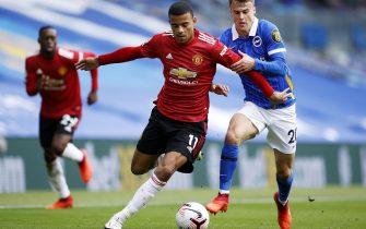 epa08698830 Solly March (R) of Brighton in action against Mason Greenwood of Manchester United during the English Premier League match between Brighton and Manchester United in Brighton, Britain, 26 September 2020.  EPA/John Sibley / POOL EDITORIAL USE ONLY. No use with unauthorized audio, video, data, fixture lists, club/league logos or 'live' services. Online in-match use limited to 120 images, no video emulation. No use in betting, games or single club/league/player publications.