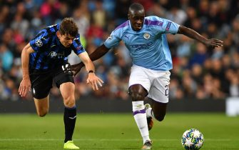 Manchester City's French defender Benjamin Mendy (R) tries to hold off Atalanta's Dutch midfielder Marten de Roon *(L) during the UEFA Champions League Group C football match between Manchester City and Atalanta at the Etihad Stadium in Manchester, northwest England on October 22, 2019. (Photo by Paul ELLIS / AFP) (Photo by PAUL ELLIS/AFP via Getty Images)