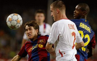 FC Barcelona's Bojan Krkic (L) and Eric Abidal vies with Olympique Lyonnais' Francois Clerc (C) during their Champions League football match at the Nou Camp in Barcelona 19 September 2007. AFP PHOTO/CESAR RANGEL (Photo credit should read CESAR RANGEL/AFP via Getty Images)