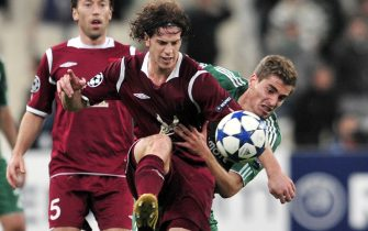 Panathinaikos' Charis Mavrias (R) fights for the ball with Rubin Kazan's Cristian Ansaldi during their group D champions league football game at the Athens Olympic stadium on October 20, 2010. AFP PHOTO / Aris Messinis (Photo credit should read ARIS MESSINIS/AFP via Getty Images)