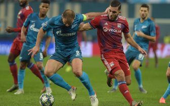Zenit St. Petersburg's Serbian defender Branislav Ivanovic and Lyon's French forward Rayan Cherki vie for the ball during the UEFA Champions League group G football match between Zenit and Lyon at the Gazprom Arena in Saint Petersburg on November 27, 2019. (Photo by Olga MALTSEVA / AFP) (Photo by OLGA MALTSEVA/AFP via Getty Images)