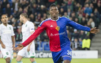 epa04476550 Basel's Breel Embolo, center, celebrates his first goal during an UEFA Champions League group B matchday 4 soccer match between Switzerland's FC Basel 1893 and Bulgaria's PFC Ludogorets Razgrad in the St. Jakob-Park stadium in Basel, Switzerland, on Tuesday, November 4, 2014.  EPA/PATRICK STRAUB