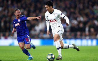 LONDON, ENGLAND - NOVEMBER 26: Heung-Min Son of Tottenham Hotspur and Daniel Podence of Olympiacos FC in action  during the UEFA Champions League group B match between Tottenham Hotspur and Olympiacos FC at Tottenham Hotspur Stadium on November 26, 2019 in London, United Kingdom. (Photo by Chloe Knott - Danehouse/Getty Images)