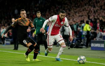 AMSTERDAM, NETHERLANDS - DECEMBER 10: (L-R) Rodrigo of Valencia, Hakim Ziyech of Ajax during the UEFA Champions League  match between Ajax v Valencia at the Johan Cruijff Arena on December 10, 2019 in Amsterdam Netherlands (Photo by Erwin Spek/Soccrates/Getty Images)