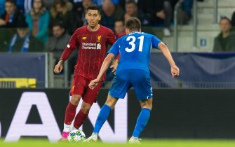 GENK, BELGIUM - OCTOBER 23: Roberto Firmino of FC Liverpool and Joakim Maehle of KRC Genk battle for the ball during the UEFA Champions League group E match between KRC Genk and Liverpool FC at Luminus Arena on October 23, 2019 in Genk, Belgium. (Photo by TF-Images/Getty Images)