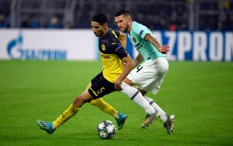 Dortmund's Moroccan defender Achraf Hakimi (L) and Inter Milan's Italian defender Cristiano Biraghi vie for the ball during the UEFA Champions League Group F football match BVB Borussia Dortmund v Inter Milan in Dortmund, western Germany, on November 5, 2019. (Photo by INA FASSBENDER / AFP) (Photo by INA FASSBENDER/AFP via Getty Images)