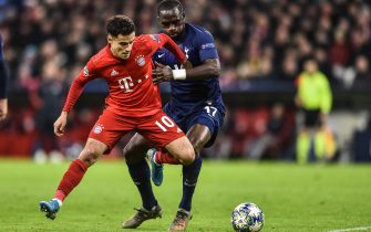 MUNICH, GERMANY - DECEMBER 11: Moussa Sissoko of Tottenham Hotspur tackles Philippe Coutinho of FC Bayern Muenchen during the UEFA Champions League group B match between Bayern Muenchen and Tottenham Hotspur at Allianz Arena on December 11, 2019 in Munich, Germany. (Photo by Lukasz Laskowski/PressFocus/MB Media/Getty Images)