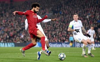 LIVERPOOL, ENGLAND - NOVEMBER 05: Mohamed Salah of Liverpool challenges for the ball with Jhon Lucumi of KRC Genk during the UEFA Champions League group E match between Liverpool FC and KRC Genk at Anfield on November 05, 2019 in Liverpool, United Kingdom. (Photo by Laurence Griffiths/Getty Images)