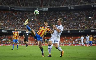VALENCIA, SPAIN - AUGUST 11:  Joao Cancelo (L) of Valencia competes for the ball with Robin Gosens of Atalanta during the pre-season friendly match between Valencia CF and Atalanta BC at Estadio Mestalla on August 11, 2017 in Valencia, Spain.  (Photo by Quality Sport Images/Getty Images)