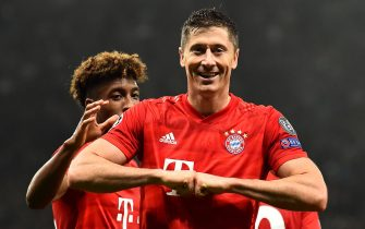 Bayern Munich's Polish forward Robert Lewandowski celebrates after scoring their second goal during the UEFA Champions League Group B football match between Tottenham Hotspur and Bayern Munich at the Tottenham Hotspur Stadium in north London, on October 1, 2019. (Photo by Glyn KIRK / IKIMAGES / AFP)        (Photo credit should read GLYN KIRK/AFP via Getty Images)