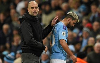 Manchester City's Spanish manager Pep Guardiola (L) gestures to Manchester City's Argentinian striker Sergio Aguero (R) as he leaves the pitch after appearing to pick up an injury during the English Premier League football match between Manchester City and Chelsea at the Etihad Stadium in Manchester, north west England, on November 23, 2019. (Photo by Oli SCARFF / AFP) / RESTRICTED TO EDITORIAL USE. No use with unauthorized audio, video, data, fixture lists, club/league logos or 'live' services. Online in-match use limited to 120 images. An additional 40 images may be used in extra time. No video emulation. Social media in-match use limited to 120 images. An additional 40 images may be used in extra time. No use in betting publications, games or single club/league/player publications. /  (Photo by OLI SCARFF/AFP via Getty Images)