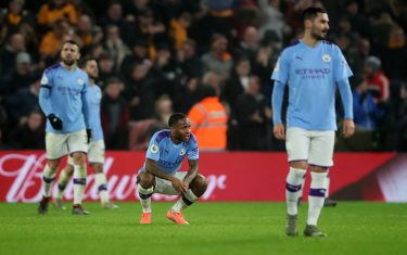 WOLVERHAMPTON, ENGLAND - DECEMBER 27: Raheem Sterling of Manchester City among dejected teammates after the 2nd Wolves goal during the Premier League match between Wolverhampton Wanderers and Manchester City at Molineux on December 27, 2019 in Wolverhampton, United Kingdom. (Photo by Marc Atkins/Getty Images)