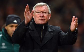 Manchester United's Scottish manager Alex Ferguson applauds as he leaves the pitch after the UEFA Champions League round of 16 second leg football match between Manchester United and Real Madrid at Old Trafford in Manchester, northwest England, on March 5, 2013. Real Madrid won 2-1 (3-2 on aggregate). AFP PHOTO/ANDREW YATES        (Photo credit should read ANDREW YATES/AFP via Getty Images)