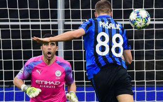 Atalanta's Croatian midfielder Mario Pasalic (R) scores a header past Manchester City's Chilean goalkeeper Claudio Bravo to equalize during the UEFA Champions League Group C football match Atalanta Bergamo vs Manchester City on November 6, 2019 at the San Siro stadium in Milan. (Photo by Miguel MEDINA / AFP) / The erroneous mention appearing in the metadata of this photo by Miguel MEDINA has been modified in AFP systems in the following manner: Manchester City's Chilean goalkeeper Claudio Bravo instead of Manchester City's Brazilian goalkeeper Ederson. Please immediately remove the erroneous mention from all your online services and delete it from your servers. If you have been authorized by AFP to distribute it to third parties, please ensure that the same actions are carried out by them. Failure to promptly comply with these instructions will entail liability on your part for any continued or post notification usage. Therefore we thank you very much for all your attention and prompt action. We are sorry for the inconvenience this notification may cause and remain at your disposal for any further information you may require. (Photo by MIGUEL MEDINA/AFP via Getty Images)