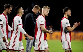 epa08061231 Ajax players react after the UEFA Champions League Group H soccer match between Ajax and Valencia in Amsterdam, The Netherlands, 10 December 2019.  EPA/OLAF KRAAK