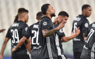 Lyon's Memphis Depay jubilates after scoring the goal (0-1) during the UEFA Champions League round of 16 second leg soccer match Juventus FC vs Olympique Lyon at the Allianz Stadium in Turin, Italy, 07 August 2020.ANSA/ALESSANDRO DI MARCO