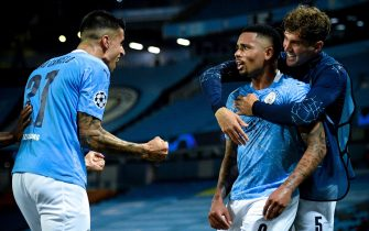 epa08590675 Manchester City's Gabriel Jesus (C) celebrates with his teammates after scoring the 2-1 lead during the UEFA Champions League Round of 16 second leg soccer match between Manchester City and Real Madrid in Manchester, Britain, 07 August 2020.  EPA/Oli Scarff / POOL