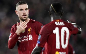 epa08287435 Liverpool captain Jordan Henderson (L) and teammate Sadio Mane during the UEFA Champions League Round of 16, second leg match between Liverpool FC and Atletico Madrid in Liverpool, Britain, 11 March 2020.  EPA/PETER POWELL