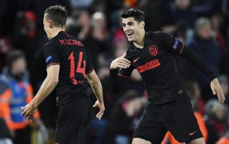 epa08287540 Marcos Llorente (L) of Atletico celebrates with teammate Alvaro Morata after soring his second goal during the UEFA Champions League Round of 16, second leg match between Liverpool FC and Atletico Madrid in Liverpool, Britain, 11 March 2020.  EPA/PETER POWELL
