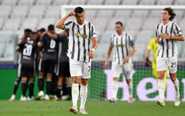 TURIN, ITALY - AUGUST 07: Cristiano Ronaldo of Juventus looks dejected after his team concede during the UEFA Champions League round of 16 second leg match between Juventus and Olympique Lyon at Allianz Stadium on August 07, 2020 in Turin, Italy. (Photo by Valerio Pennicino/Getty Images)