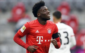 epa08440004 Bayern Munich's Alphonso Davies celebrates scoring during the German Bundesliga soccer match Bayern Munich vs Eintracht Frankfurt in Munich, Germany, 23 May 2020. The German Bundesliga is the world's first major soccer league to resume after a two-month suspension because of the Coronavirus pandemic.  EPA/ANDREAS GEBERT / POOL DFL regulations prohibit any use of photographs as image sequences and/or quasi-video.