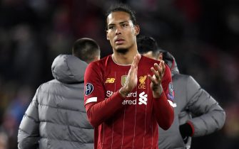 epa08287567 Virgil van Dijk of Liverpool applauds fans after the UEFA Champions League Round of 16, second leg match between Liverpool FC and Atletico Madrid in Liverpool, Britain, 11 March 2020.  EPA/PETER POWELL