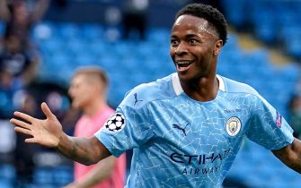 epa08590606 Manchester City's Raheem Sterling celebrates with his teammates after scoring the 1-0 lead during the UEFA Champions League Round of 16 second leg soccer match between Manchester City and Real Madrid in Manchester, Britain, 07 August 2020.  EPA/Dave Thompson / POOL