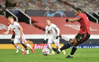 epa08781975 Anthony Martial of Manchester United makes it 4-0 from the spot during the UEFA Champions League group H match Manchester United vs RB Leipzig in Manchester, Britain 28 October 2020.  EPA/Peter Powell