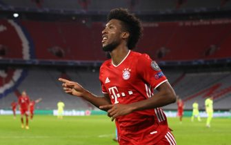 epa08763284 Kingsley Coman of Bayern Munich celebrates after scoring his team's fourth goal during the UEFA Champions League Group A stage match between FC Bayern Munich and Atletico Madrid at Allianz Arena in Munich, Germany, 21 October 2020.  EPA/Alexander Hassenstein / POOL