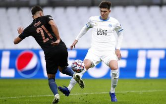 epa08779067 Manchester City's Ferran Torres (L) and Olympique Marseille's Leonardo julian Balerdi Rosa (R) in action during the UEFA Champions League Group C soccer match between Marseille and Manchester City at the Orange Velodrome stadium, in Marseille, France 27 October 2020.  EPA/Guillaume Horcajuelo / POOL