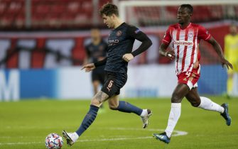 PIRAEUS, GREECE - NOVEMBER 25: John Stones of Manchester City and Mohamed Camara of Olympiacos FC during the UEFA Champions League Group C stage match between Olympiacos FC and Manchester City at Karaiskakis Stadium on November 25, 2020 in Piraeus, Greece. (Photo by MB Media/Getty Images)