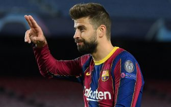 Barcelona's Spanish defender Gerard Pique celebrates his goal during the UEFA Champions League group G football match between Barcelona and Dynamo Kiev at the Camp Nou stadium in Barcelona, on November 4, 2020. (Photo by LLUIS GENE / AFP) (Photo by LLUIS GENE/AFP via Getty Images)
