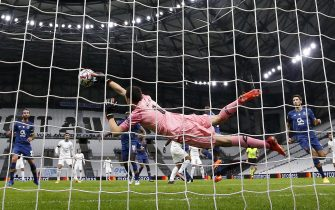 epa08842267 Porto's goalkeeper Austin Marchesin in action during the UEFA Champions League Group C soccer match between Olympique Marseille and FC Porto in Marseille, France, 25 November 2020.  EPA/Guillaume Horcajuelo