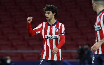epa08855799 Atletico Madrid's Joao Felix (L) celebrates after scoring the 1-0 lead during the UEFA Champions League group A soccer match between Atletico Madrid and Bayern Munich in Madrid, Spain, 01 December 2020.  EPA/Juanjo Martin