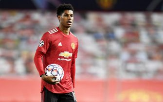 epa08782011 Marcus Rashford of Manchester United walks off with the match ball after scoring a hattrick in the UEFA Champions League group H match Manchester United vs RB Leipzig in Manchester, Britain 28 October 2020. Manchester United won 5-0.  EPA/Peter Powell